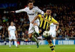 MADRID, SPAIN - NOVEMBER 06:  Mesut Oezil of Madrid and Ilkay Guendogan of Dortmund battle for the ball during the UEFA Champions League Group D match between Real Madrid and Borussia Dortmund at Estadio Santiago Bernabeu on November 6, 2012 in Madrid, Spain.  (Photo by Dennis Grombkowski/Bongarts/Getty Images)